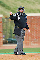 Home plate umpire Reid Churchill makes a strike call during the Big South baseball game between the Coastal Carolina Chanticleers and the High Point Panthers at Willard Stadium on March 14, 2014 in High Point, North Carolina.  The Panthers defeated the Chanticleers 3-0.  (Brian Westerholt/Four Seam Images)