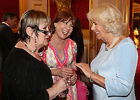 12 July 2016 - London, England - Camilla, Duchess of Cornwall, talks to Kathy Lette and Jenni Murray as she hosts the 30th Anniversary Garden Party for the National Osteoporosis Society in St James Palace in London. Due to inclement weather the event was moved indoors. The Duchess of Cornwall has been connected with the charity for nearly 30 years. Photo Credit: ALPR/AdMedia