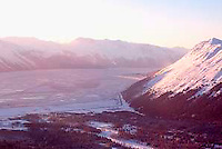 View from top of Alyeska Ski Resort at sunset, across Turnagain Arm, north to Anchorage, Alaska