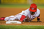 7 October 2017: Washington Nationals outfielder Victor Robles dives back to first as a pinch runner in the 8th inning during the second NLDS game against the Chicago Cubs at Nationals Park in Washington, DC. The Nationals defeated the Cubs 6-3 and even their best of five Postseason series at one game apiece. Mandatory Credit: Ed Wolfstein Photo *** RAW (NEF) Image File Available ***