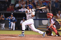 Asheville Tourists catcher Jose Briceno #4 swings at a pitch during a game against the Hagerstown Sun at McCormick Field on September 8, 2014 in Asheville, North Carolina. The Tourists defeated the Suns 16-7. (Tony Farlow/Four Seam Images)