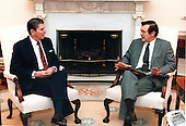 Washington, DC - File photo -- United States President Ronald Reagan meets with Ambassador Donald Rumsfeld, Personal Representative in the Middle East, in the Oval Office.  Ambassador Rumsfeld reported to the President on his recent visit to the Middle East.  Photo released December 22, 1983.<br /> Mandatory Credit: Credit: Bill Fitz-Patrick / White House via CNP
