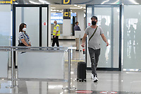 Passengers from Dusseldorf Germany arrived at Palma de Mallorca airport, they are the first tourists to visit Spain since confinement began due to the COVID-19 crisis. The government of Spain has allowed the entry of 10,900 German tourists to the Balearic Islands on 47 flights throughout the entire month of June to test the viability of tourist recovery. (Photo by Joan Armengual/VIEWpress via Getty Images).