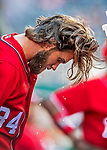 29 July 2017: Washington Nationals right fielder Bryce Harper cools off with some water in the dugout prior to a game against the Colorado Rockies at Nationals Park in Washington, DC. The Rockies defeated the Nationals 4-2 in the first game of their 3-game weekend series. Mandatory Credit: Ed Wolfstein Photo *** RAW (NEF) Image File Available ***