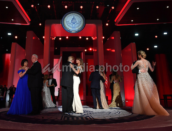 President Donald Trump and First Lady Melania Trump dance along with family members and Vice President Mike Pence and his wife Karen Pence at the Liberty Ball at the Washington Convention Center on January 20, 2017 in Washington, D.C. Trump will attend a series of balls to cap his Inauguration day. Photo Credit: Kevin Dietsch/CNP/AdMedia