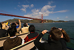 San Francisco, California: Tour boat with tourists near Golden Gate Bridge and Marin Headlands. Photo 15-casanf78238. Photo copyright Lee Foster.