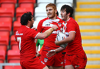 PICTURE BY VAUGHN RIDLEY/SWPIX.COM...Rugby League - International Friendly - England Knights v France - Leigh Sports Village, Leigh, England - 15/10/11…England's Stefan Ratchford celebrates his try with Matty Smith and Kris Welham.