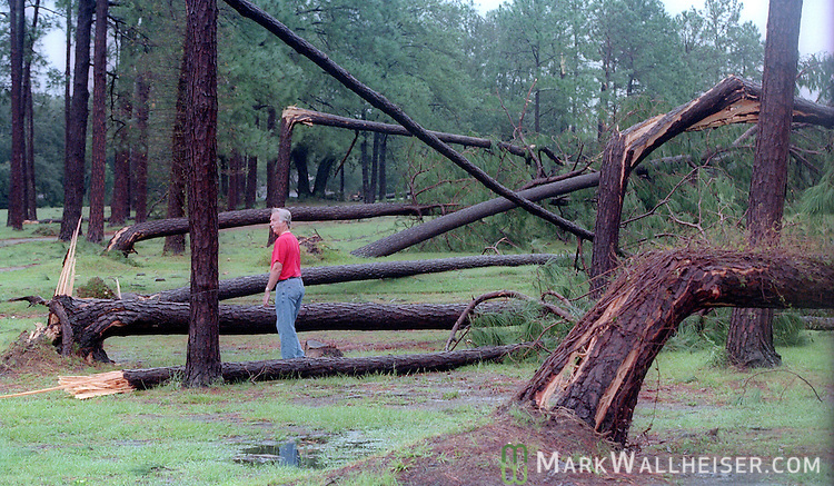 A man walks though Edgewater Estates as the eye of Hurricane Georges passes over the Biloxi, Mississippi coast September 29, 1998.  Georges made six landfalls through the Caribbean Sea and Gulf of Mexico before making it's 7th and final landfall near Biloxi.  604 people were killed mostly in Dominican Republic and haiti.  Because of the extensive damage, the name Georges was retired and will never be used again.