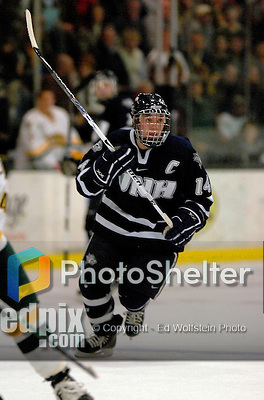 """5 January 2007: University of New Hampshire forward and team captain Josh Ciocco (14) from Atco, NJ, in action against the University of Vermont Catamounts at Gutterson Fieldhouse in Burlington, Vermont. The UNH Wildcats defeated Vermont 7-1 in front of a record setting 48th consecutive sellout at """"the Gut""""...Mandatory Photo Credit: Ed Wolfstein Photo.<br />"""
