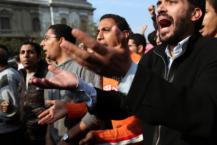 Protesters march in downtown Cairo, Egypt, Jan. 25, 2011. The day was an official holiday in honor of the achievements of police, but thousands of demonstrators came out to protest corruption, unemployment and police torture.