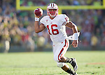 Wisconsin Badgers quarterback Russell Wilson (16) carries the ball during the 2012 Rose Bowl NCAA football game against the Oregon Ducks in Pasadena, California on January 2, 2012. The Ducks won 45-38. (Photo by David Stluka)