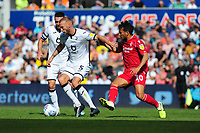 Mike van der Hoorn of Swansea City vies for possession with João Carvalho of Nottingham Forest during the Sky Bet Championship match between Swansea City and Nottingham Forest at the Liberty Stadium in Swansea, Wales, UK. Saturday 14 September 2019