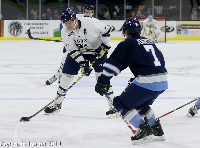 SIOUX FALLS, SD - OCTOBER 17:  Nikolas Koberstein #7 from the Sioux Falls Stampede looks to pass the puck around Will Johnson #7 from the Madison Capitols in the first period Friday night at the Denny Sanford Premiere Center. (Photo/Dave Eggen/Inertia)
