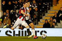 Aleksandar Mitrovic of Fulham FC is challenged by Richard Stearman of Sheffield United during the Sky Bet Championship match between Fulham and Sheff United at Craven Cottage, London, England on 6 March 2018. Photo by Carlton Myrie.