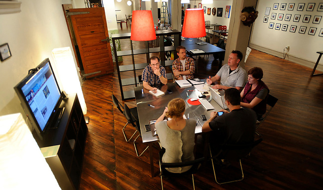 Members of the Candy Factory Co-Working space, Matt Lester, left rear, Steve Zimmermann, center rear, MAx Phillips, right rear, Anne Kirby, right front, Mark Reinmiller, center front, and Laurel Wood, left front, conduct a business meeting Thursday, Sept. 30, 2010 in lancaster, Pa. (Bradley C Bower/KeyStone Edges)