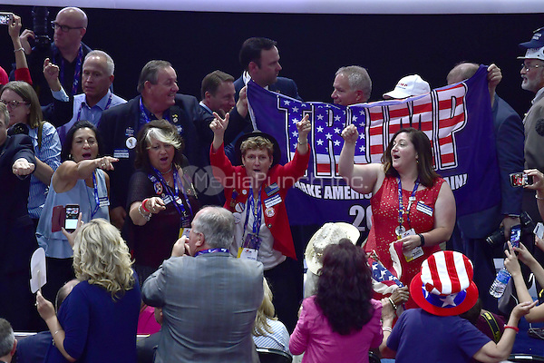Delegates celebrate on the floor prior to the fifth session at the 2016 Republican National Convention held at the Quicken Loans Arena in Cleveland, Ohio on Thursday, July 21, 2016.<br /> Credit: Ron Sachs / CNP/MediaPunch<br /> (RESTRICTION: NO New York or New Jersey Newspapers or newspapers within a 75 mile radius of New York City)