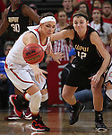 SIOUX FALLS, SD - MARCH 9: Caitlyn Tolen #12 of IUPUI and Kelly Steward #15 of USD battle for the ball in the second half of their semi-final round Summit League Championship Tournament game Monday afternoon at the Denny Sanford Premier Center in Sioux Falls, SD. (Photo by Dick Carlson/Inertia)