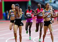 06 JUL 2012 - PARIS, FRA - Mariem Selsouli of Morocco (left) celebrates winning the women's 2012 Meeting Areva 1500m race in the Stade de France in Paris, France .(PHOTO (C) 2012 NIGEL FARROW)