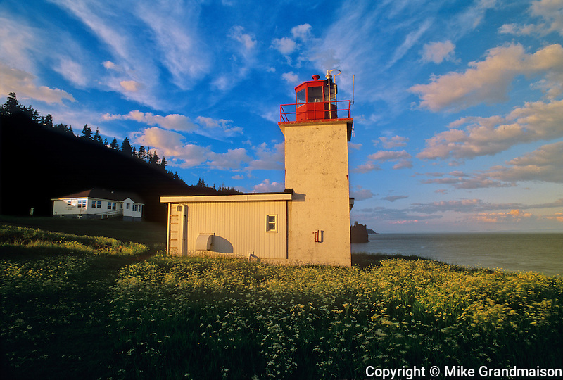 Cape d&rsquo;Or Lighthouse on the Bay of Fundy at sunset<br /> Advocate Harbour<br /> Nova Scotia<br /> Canada