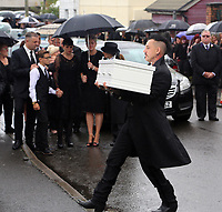 "COPY BY TOM BEDFORD<br /> Pictured: Paul Black carries the white coffin of his daughter Pearl to the Jerusalem Baptist Chapel in Merthyr Tydfil, Wales, UK. Friday 18 August 2017<br /> Re: The funeral of a toddler who died after a parked Range Rover's brakes failed and it hit a garden wall which fell on top of her will be held today at Jerusalem Baptist Chapel in Merthyr Tydfil.<br /> One year old Pearl Melody Black and her eight-month-old brother were taken to hospital after the incident in south Wales.<br /> Pearl's family, father Paul who is The Voice contestant and mum Gemma have said she was ""as bright as the stars""."
