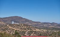 A distant view of dome of the 9.2 m Hobby-Eberly Telescope from on top of Mount Locke in the Davis Mountains. It houses one of the largest optical telescopes in the world. This telescope is run by University of Texas along with several other universities and is located on top of the summit of Mt. Fowlkes at 6660 ft in the Davis Mountains with the closest community being Fort Davis in Jeff Davis county Texas. This area is a dry and very dark skies area so it is perfect for star gazing.