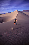 A picture of a woman down a sand dune in Death Valey, CA.