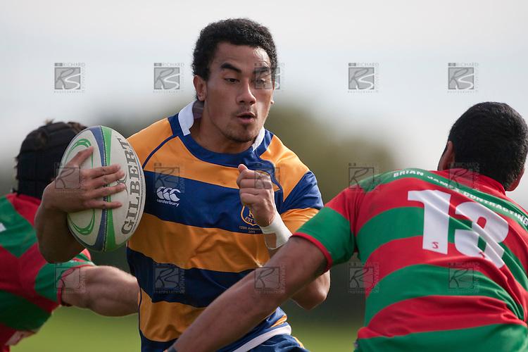Richie Ah Chong looks to avoid Ray Laulala's tackle. Counties Manukau Premier Club Rugby game between Waiuku and Patumahoe, played at Waiuku on Saturday April 23rd 2011. Patumahoe won 21 - 20 after leading 6 - 0 at halftime.