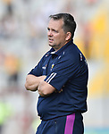 Clareman David Fitzgerald, Wexford Manager, on the sideline in the closing stages of the All-Ireland quarter final at Pairc Ui Chaoimh. Photograph by John Kelly.