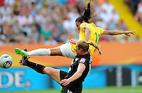 Marta (r) of team Brazil and Rachel Buehler of team USA during the FIFA Women's World Cup at the FIFA Stadium in Dresden, Germany on July 10th, 2011.