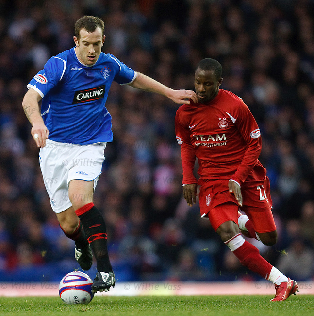 Charlie Adam holds off Sone Aluko
