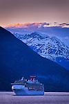 "Carnival Cruise ""Spirit"" sailing through Lynn Canal near Haines, Inside Passage, SE Alaska at sunset, in early summer."