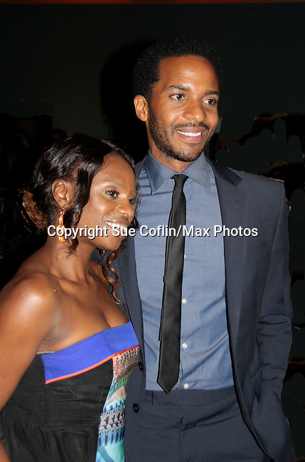 Delaina Dixon (The Gossip Table VH-1 and Diva Gals Daily) and Andre Holland starring in The Knick - on Cinemax - premiering Aug 8, 2014 - starring Andre Holland, Leon Addison Brown, David Fierro and more on July 23, 2014 at NY Academy of Medicine , New York City, New York.  (Photo by Sue Coflin/Max Photos)