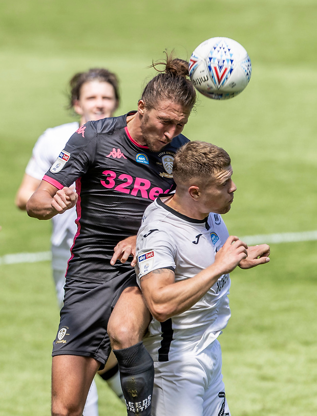 Leeds United's Kalvin Phillips (left) competing with Swansea City's Jake Bidwell <br /> <br /> Photographer Andrew Kearns/CameraSport<br /> <br /> The EFL Sky Bet Championship - Swansea City v Leeds United - Sunday 12th July 2020 - Liberty Stadium - Swansea<br /> <br /> World Copyright © 2020 CameraSport. All rights reserved. 43 Linden Ave. Countesthorpe. Leicester. England. LE8 5PG - Tel: +44 (0) 116 277 4147 - admin@camerasport.com - www.camerasport.com