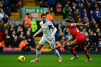 Sunday, 23 February 2014<br /> Pictured: Swansea City's Angel Rangel competes with Liverpool's Raheem Sterling for the ball<br /> Re: Barclay's Premier League, Liverpool FC v Swansea City FC v at Anfield Stadium, Liverpool Merseyside, UK.