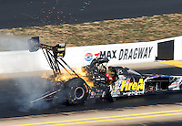 Sep 18, 2016; Concord, NC, USA; NHRA top fuel driver Leah Pritchett explodes an engine on fire during the Carolina Nationals at zMax Dragway. Mandatory Credit: Mark J. Rebilas-USA TODAY Sports