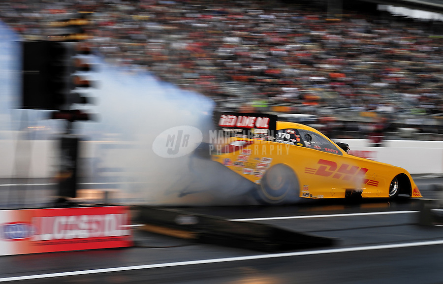 Jul. 24, 2009; Sonoma, CA, USA; NHRA funny car driver Jeff Arend does a burnout during qualifying for the Fram Autolite Nationals at Infineon Raceway. Mandatory Credit: Mark J. Rebilas-
