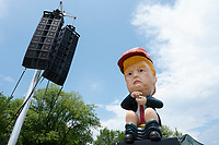 Members of the protest group Code Pink set up a statue of United States President Donald J. Trump tweeting from a golden toilet in Washington D.C., U.S. on July 4, 2019, to protest his Salute to America speech.  The group believes the presidentís participation in 4th of July celebrations is politicizing a non-political holiday.<br /> CAP/MPI/CNP<br /> ©CNP/MPI/Capital Pictures
