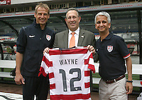 MEXICO CITY, MEXICO - AUGUST 15, 2012:  Sunil Galati head of US Soccer and coach Jurgen Klinsmann of the USA MNT present a team jersey to Earl Anthony Wayne, USA ambassador to Mexico before an international friendly match against Mexico at Azteca Stadium, in Mexico City, Mexico on August 15.