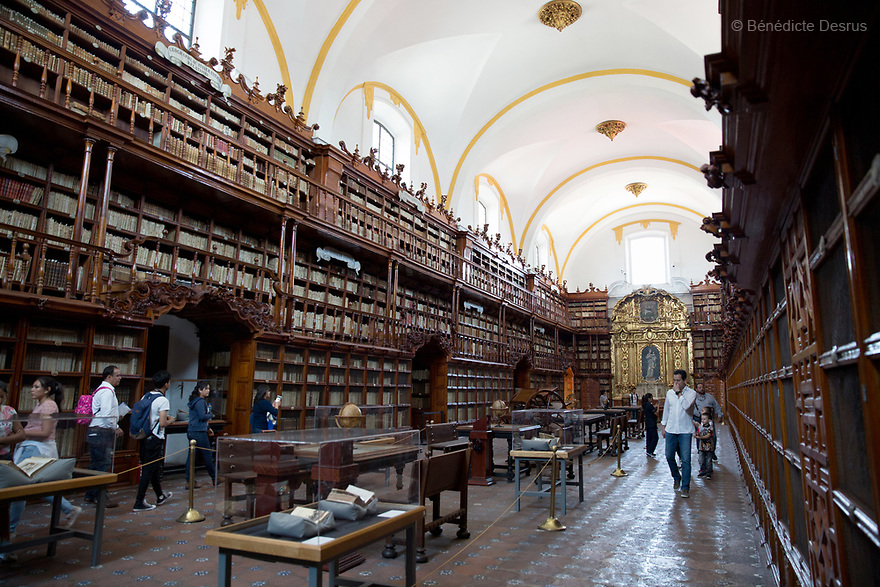 The Biblioteca Palafoxiana library in Puebla, Mexico on April 22, 2017. Founded in 1646, it was the first public library in colonial Mexico, and is sometimes considered the first in the Americas. It has more than 45,000 books and manuscripts, ranging from the 15th to the 20th century. Most books and manuscripts of the Biblioteca Palafoxiana are written in dead languages: Hebrew, Latin, Sanskrit, Chaldean and Greek, another part of the collection is written in Nahuatl, and very few pieces can be read in Spanish. In 2005, it was listed on UNESCO's Memory of the World Register. Photo by Bénédicte Desrus