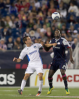 San Jose Earthquakes midfielder Sam Cronin (4) and New England Revolution midfielder Shalrie Joseph (21) battle for head ball. In a Major League Soccer (MLS) match, the San Jose Earthquakes defeated the New England Revolution, 2-1, at Gillette Stadium on October 8, 2011.