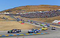 Jun. 21, 2009; Sonoma, CA, USA; NASCAR Sprint Cup Series driver Denny Hamlin (11) leads Kurt Busch (2) during the SaveMart 350 at Infineon Raceway. Mandatory Credit: Mark J. Rebilas-
