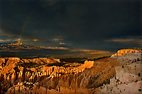 730750188 a rainbow forms over bryce point and the paunsaugunt plateau  during a monsoon summer thunderstorm utah united states