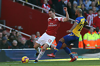 Stephan Lichtsteiner of Arsenal and Nathan Redmond of Southampton during Arsenal vs Southampton, Premier League Football at the Emirates Stadium on 24th February 2019