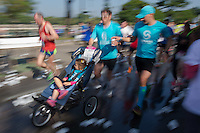 Participant runs with a pram during the Budapest Half Marathon in Budapest, Hungary on September 13, 2015. ATTILA VOLGYI