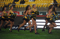 Hurricanes cheerleaders seek shelter from the rain. Super 15 rugby match - Crusaders v Hurricanes at Westpac Stadium, Wellington, New Zealand on Saturday, 18 June 2011. Photo: Dave Lintott / lintottphoto.co.nz
