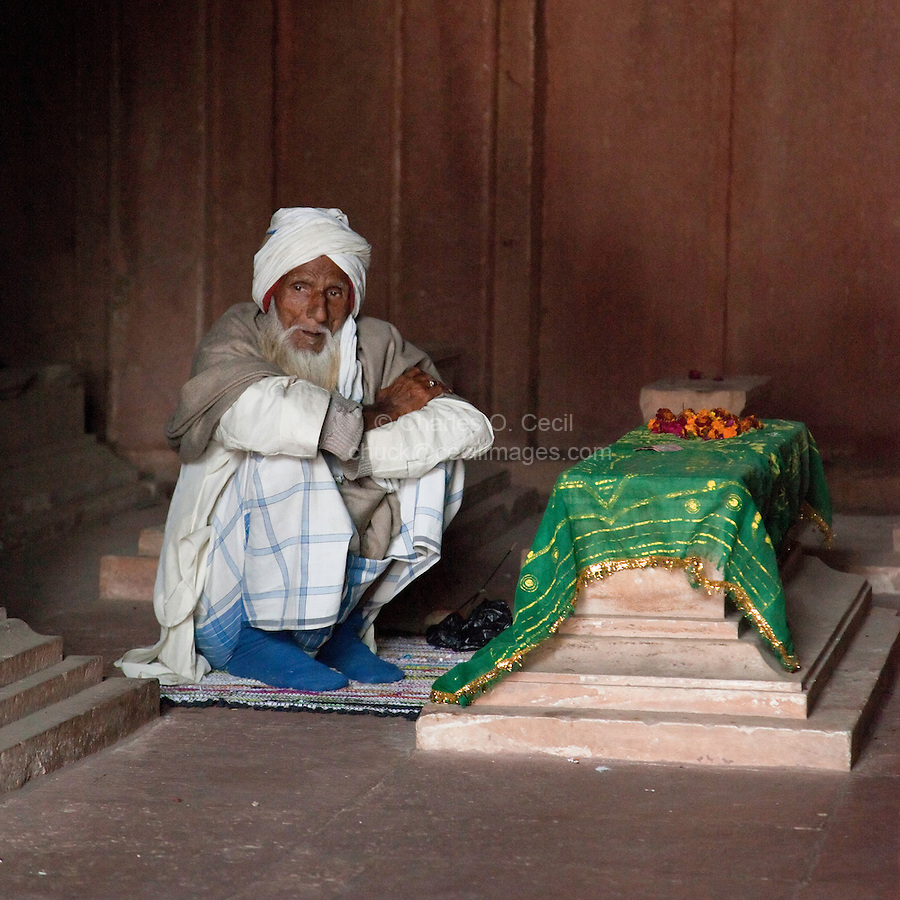 Fatehpur Sikri, Uttar Pradesh, India.  Old Man Sitting by a Grave in the Jama Masjid (Dargah Mosque).