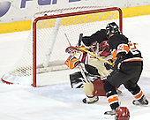 Patrick Mullen scores on the empty side of Eric Leroux's net despite Max Cousins' checking - The Princeton University Tigers defeated the University of Denver Pioneers 4-1 in their first game of the Denver Cup on Friday, December 30, 2005 at Magness Arena in Denver, CO.