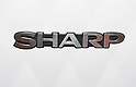 The Sharp Corp. logo is seen at an electronics store, in Tokyo, September 9th, 2012..Sharp Corp. announced that it is offering Japanese real estate including the Osaka headquarters as collateral to get new bank loans up to 150 billion yen or $1.9 billion from two of its main creditor banks..Sharp is currently in talks with Hon Hai Precision Industry over plans for the company to buy about 10 percent stake.
