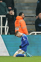 1st January 2020; St James Park, Newcastle, Tyne and Wear, England; English Premier League Football, Newcastle United versus Leicester City; James Maddison of Leicester City slides on his knees in celebration after he scores in the 39th minute to make it 0- 2 with a Newcastle fan showing his opinion  - Strictly Editorial Use Only. No use with unauthorized audio, video, data, fixture lists, club/league logos or 'live' services. Online in-match use limited to 120 images, no video emulation. No use in betting, games or single club/league/player publications