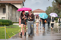 Shelby Flavin '17, left, and Marin Weiskopf '17 walk through a rainy quad on Friday. Shelby is done with finals and Marin has one more final tomorrow in chemistry. Students walk through the quad on a rainy Friday, Dec. 12, 2014. (Photo by Marc Campos, Occidental College Photographer)